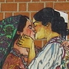 section of a mural of two italian women kissing