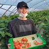 Suga smiling with his strawberries