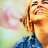 Closeup of Rose Tyler from Doctor Who, grinning.