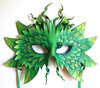 A Green Man mask: leaves shaped together to make the face of a growing green creature
