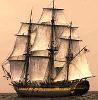 A sepia-toned image of a three-masted sailing ship on the sea.