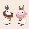A pair of rabbits wearing large American donuts as collars.