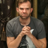 Liam O'Brien during an episode of Critical Role, clasping his hands with an intense scowl