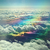 icon of a rainbow in between white fluffy clouds