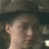 2004 Daniela Denby Ashe as Margaret Hale, close of up of face, eyes cast down, speaking to Hannah Thornton in Malborough Mills after John Thornton has 'failed'.
