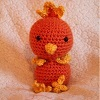 a crocheted torchic in a whiteish background