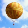 Orange and yellow hot air balloon against blue sky