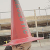 Frank Iero with a traffic cone on his head