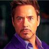 Robert Downey Jr. in a purple shirt staring intensely