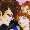 A drawing of a young man with a pompadour and a young woman with a ponytail, leaning their foreheads together and smiling happily.