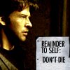 A picture of John Sheppard, from Stargate: Atlantis, with the words 'Reminder to self, don't die' in the bottom right corner.