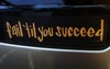 "Bumper sticker that reads ""Fail 'til you succeed."""