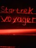 A diy red led lit Startrek Voyager decoration