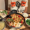 two cats in pumpkin masks sitting infront of a large bowl of vegetables