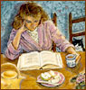 Woman reading at the kitchen table