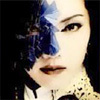 Image from the Takarazuka poster for their production of Phantom of the Opera, Japanese woman's face half covered by blue mask