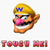 """A picture of Wario's face from Super Mario 64 DS, with the words """"TOUCH ME!"""" underneath."""