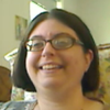 A small, cropped picture of Rebecca smiling, taken with her webcam.