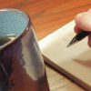 Cup of tea and a notepad with pen poised and ready