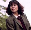 sarah jane smith in a tweed jacket looking to the left