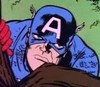 still from old TV cartoon of Steve Rogers as Captain America; he's peering over a log and looking unhappy