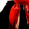 closeup of nb person's torso wearing tux and red scarf