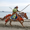 Japanese horse-archer (yabusame) galloping on beach