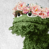 Oscar the Grouch with a flower crown.