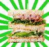 A chicken club sandwich (a sandwich with chicken, bacon and cheese) with a green sunburst behind it.