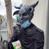 danny pudi in full demon makeup eating veggie straws