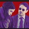 A red and purple re-colorized still from the Netflix show The Defenders in which a dark-haired man wearing glasses and a suit (Matt Murdock) looks at a dark-haired woman with a scarf (Jessica Jones) who is looking down at something out of frame.