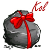 A lump of coal with a red bow and the name 'Kol'