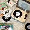 record player, albums scattered
