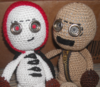 Knit dolls of 9 and my created character, Child. 9 is on the right and is turned to look at Child while Child looks ahead at the camera.