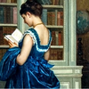 A young woman in a blue late nineteenth century dress reading a book