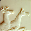 Ivory colored stag and doe relief