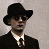 klaus nomi in a dapper hat & sunglasses