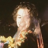 Harry Styles holding a bouquet of flowers, looking like a bride :-)