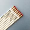 """a clean, aesthetically pleasing row of off-white #2 pencils, engraved with various phrases that all basically say """"fuck this shit"""""""