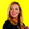 ID: An edited PNG image of Laurel Lance from the TV Show Arrow, played by Katie Cassidy, on a yellow background.