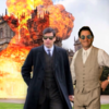 an image of Abed from Community, an Arab man wearing a long, wavy black wig and a half-unbuttoned white shirt, with his arms spread