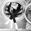 tennessee thomas sitting crosslegged in a dryer