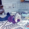 Blonde little girl lying on the floor reading.