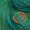 Close-up of handspun yarn with dime for scale