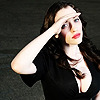 Kat Dennings looking up her hand shielding eyes