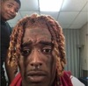 It's a picture of Lil Uzi Vert, a popular rapper, looking slightly horrified at something on the phone the picture was taken of.