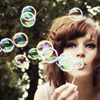 brunette blowing bubbles
