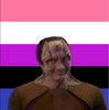 a picture of elim garak set over the genderfluid flag.