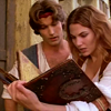 Maeve reading a mystic tome while Sinbad looks over her shoulder