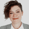 Icon ID: Tatiana Maslany with a side-swept, long taper cut hairstyle and wearing a blazer